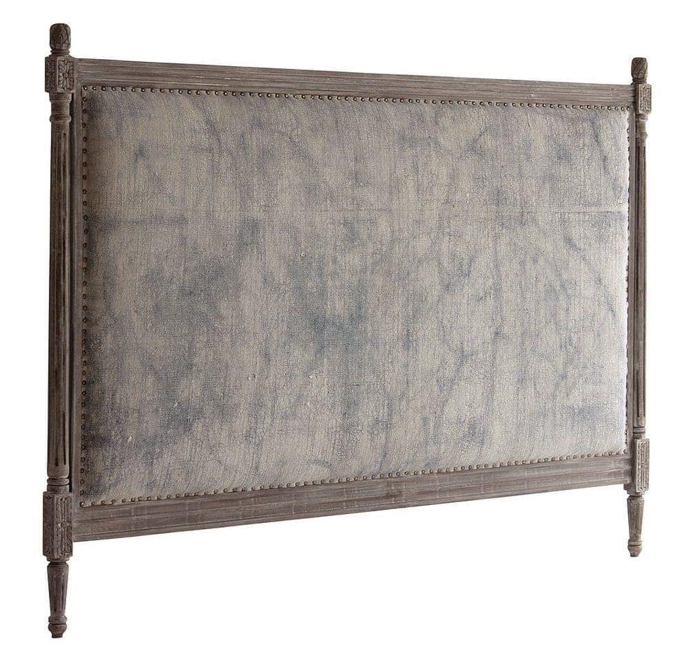 Hvidkalket sengegavl med stof